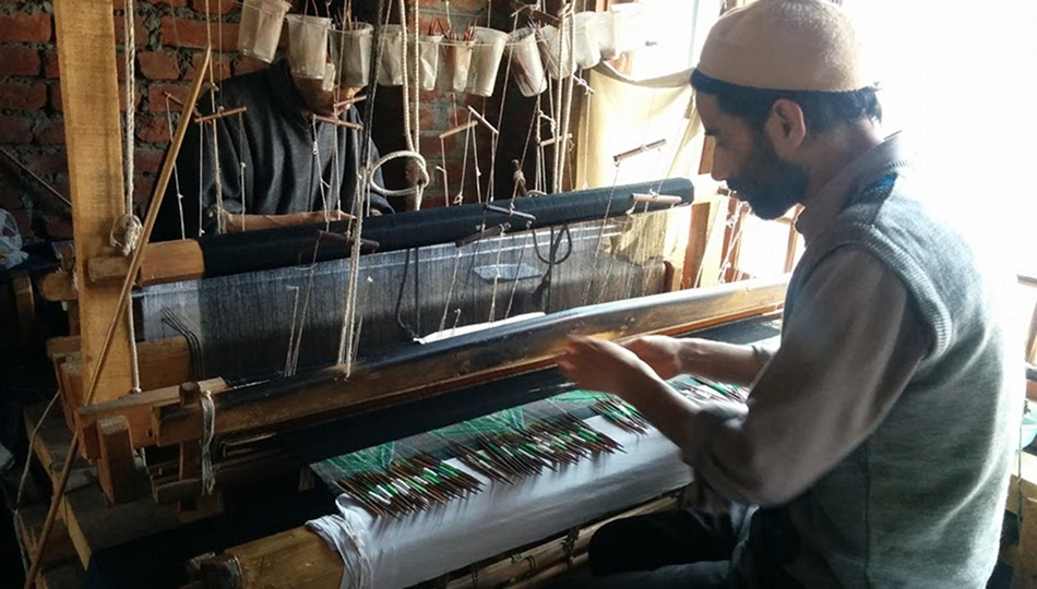 artisan working on a kani loom in Kashmir